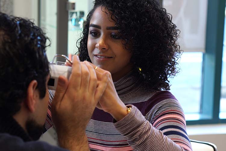 All Eye Care Doctors team member checking eyesight