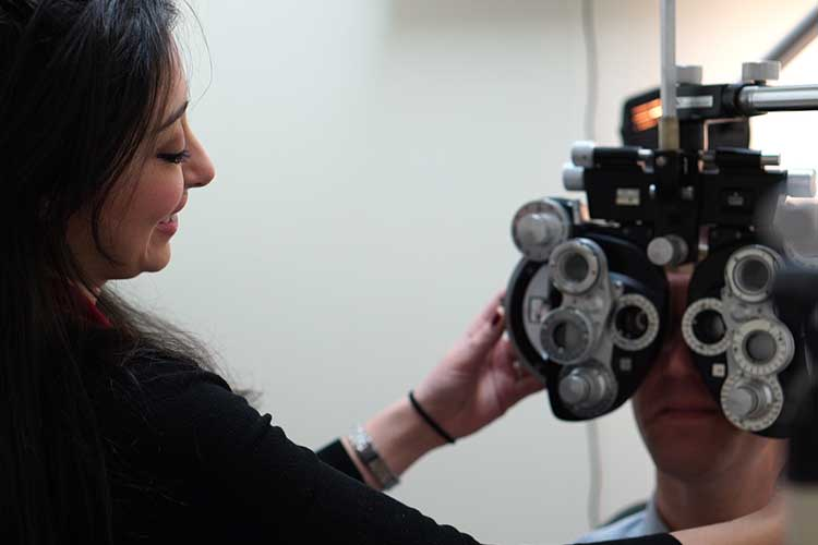 doctor adjusting patients vision