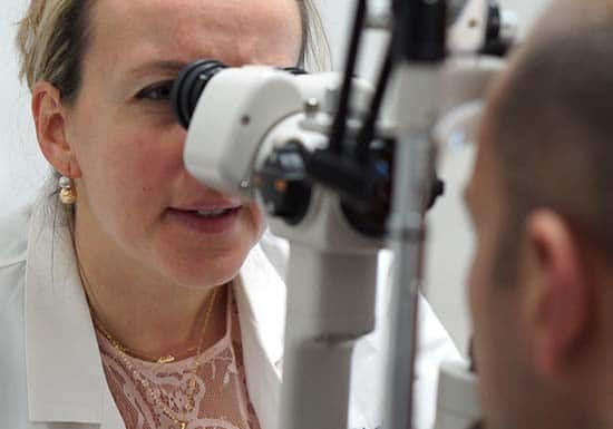 doctor checking patients eye