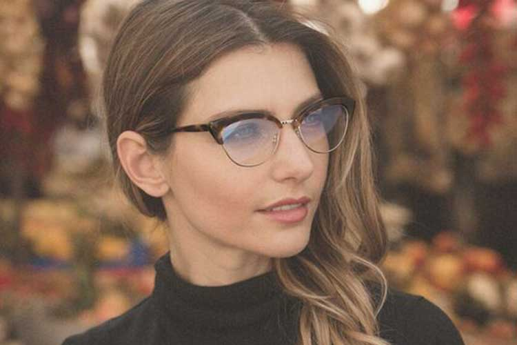 girl staring into distance design eyewear