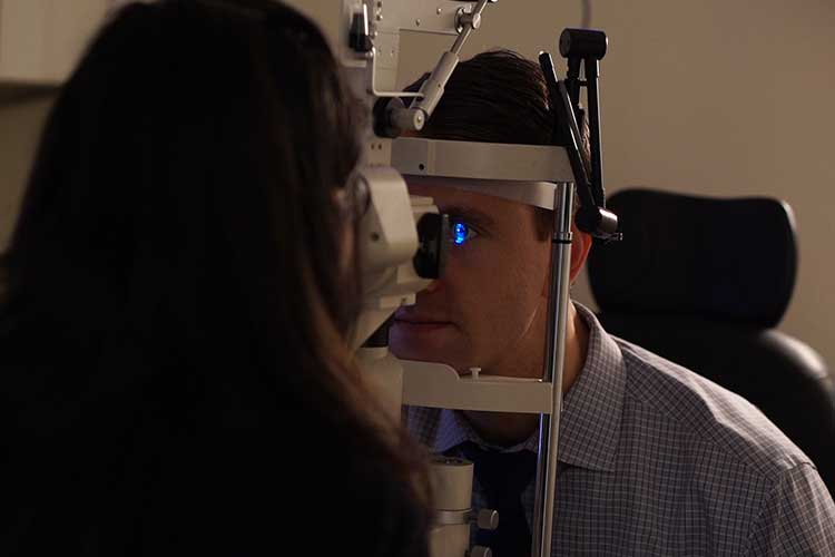 patient getting his eye examined