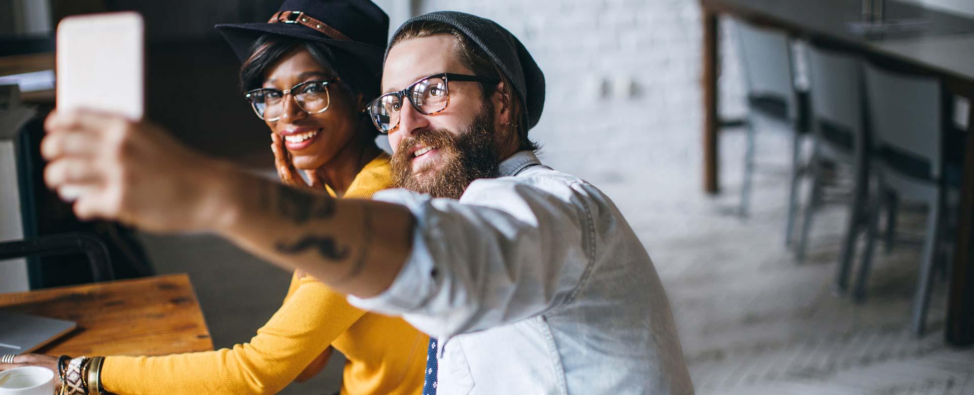 stylish sunglasses couple taking selfie